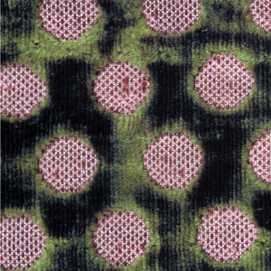 Two fragments of green cut velvet with an allover design of small circles in purple silk.