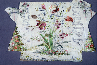 Each fragment shows a portion of a design of a bouquet of tulips and small flowers, incomplete bouquets at either side. Worked in satin stitch.