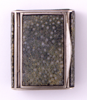 Rectangular, plated metal, snuff box type container, front, bottom, and back panels veneered with continuous piece of green shagreen, the front and back panels curved. Lid veneered with green shagreen with metal thrumb catch at front, and hinged near back. Striker on both left and right sides of box.
