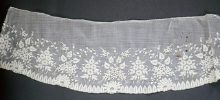 Collar and strip embroidered [white on white] in pattern of alternating floral bouquets above a border of pointed leaves and daisies.