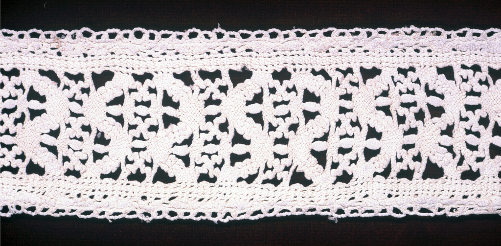 Design of horizontal bands of two geometric patterns used alternately and set between narrow borders.