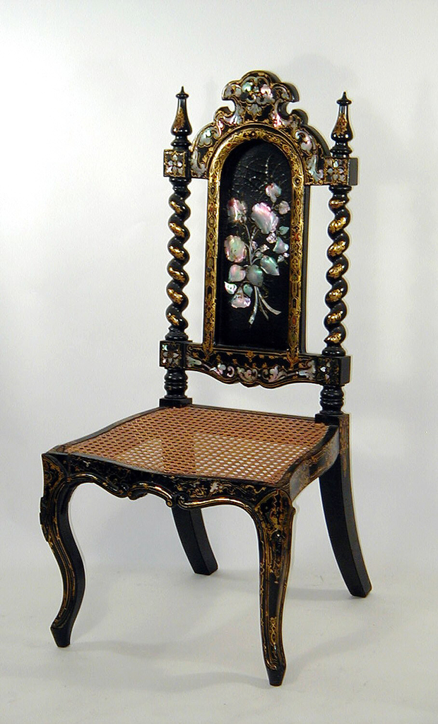 Shaped rectangular back with an arched splat inlaid with a flower-filled basket between barley-twist turned stiles headed by finials and a serpentine caned seat, on cabriole legs with scroll feet.