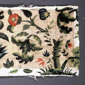 Band of crewel embroidery with fantastical foliage and flowers in blue, green and red wools on an ivory ground.