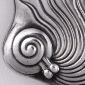 Oblong, with asymmetrical curved sides and corners, featuring abstract snail motifs, one snail with antennae on lower left corner, has attached wavy tendrils that move up case body. Second snail coiled at front end of lid, has several wavy tendrils that extend toward hinge side. Upper parts of case has mottled, hammered surface. Ornament identical on reverse. Lid hinged on side. Striker on bottom.