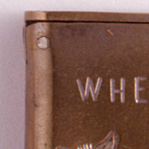 """Rectangular, with rounded sides, featuring word/picture rebus, inscribed """"When Shall We 3 [Asses] Meet Again"""", with 2 incised donkeys, substituted for text, facing one another between the number """"3"""" and """"Meet"""". No decoration on reverse. Simple, flat lid hinged on upper left. Striker on bottom."""