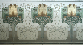 Art nouveau or mission design with repeating motif of stylized tulips. Printed in tans, browns and greens on a backgound that shades from olive green to tan at top.