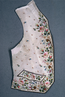 Gentleman's waistcoat panels of cream-colored ribbed silk are embroidered in a floral pattern in bright multicolored silks. Front edges and pocket have embroidered borders of dark-brown silk.