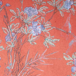 Flowering tree running vertically up the center of the fabric with pigeons perching in its branches. 1983-19-9a is on a red background, 1983-19-9b is on a silver/grey background.