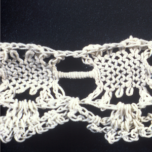 Machine woven tape with crochet edging. In all three pieces the same tape is used, but the edging varies from a,b,c.