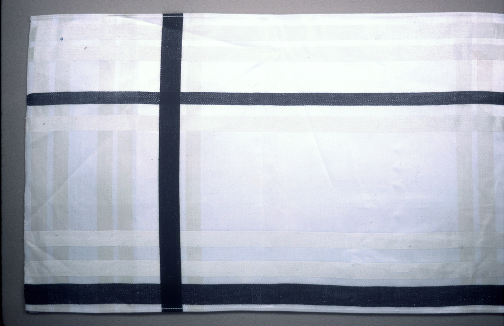Assymmetrical plaid of cream and black lines on a white ground. Same description for A and B.