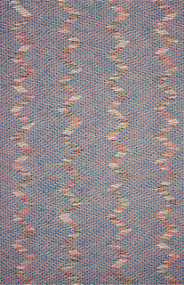 """Vertical zig-zags of mixed colors in (a) yellow predominates in the narrower stripe, blue in the wider stripe. Colorways: b. Blue/yellow c. Mauve/orange White fabric with triangular patches """"burnt out"""" to make small sheer areas some of which are partially over-printed in blue."""
