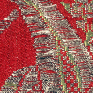 Length of red silk damask brocaded with silver and yellow/green silk. Both the damask design and the brocade design show sinuous curving elements and exotic blossoms.
