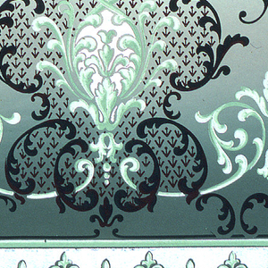 """A series of foliate medallions which alternate small fleurs-de-lis made of """"C"""" scroll shapes. Bottom contains a scalloped border made up of acanthus leafs. Printed in shades of green."""