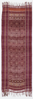 Silk patola with tied resist pattern in purple and yellow showing vertical lines and central pattern of diamonds and stars with border of diamonds and hearts. Stripes run parallel to selvage on either side. Fringe at top and bottom.