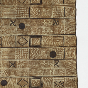 Large rectangular tapa, printed with blocks of geometric diamond and zigzag patterns in reddish-brown in a repeating fashion. Dark brown diamonds, squares and dots are hand-painted and do not repeat.