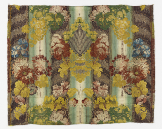 Woven textile fragments in symmetrical large-scale design of central palmette flanked by columns encircled by acanthus leaves, flowers, foliage, and bunches of grapes brocaded in multicolored silks and silver metallic thread.