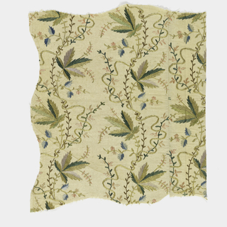 Embroidered in serpentine design of leaves, tendrils and ribbons, in light colored silks and metal thread.