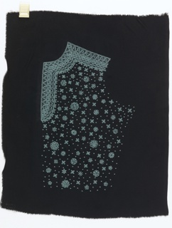 Side panel of a blouse front in black cloth with an embroidered design of simple rosettes worked in small, bright blue beads.