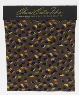 Design with small leaves in yellow, green, orange, purple, and black on a brown background.