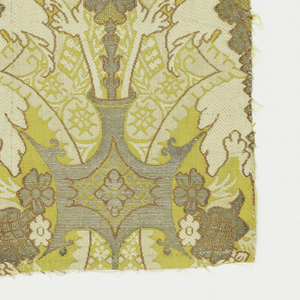 Brilliant yellow satin ground with a profuse symmetrical design of silver, rose and ivory blossoms and serrated leaves in vases.