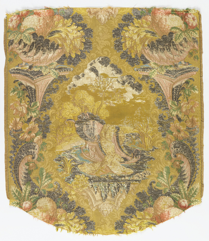 """Woven silk  with a design of a garden pedestal with large shell and florals, framing a landscape. With some elements of the """"bizarre"""" style. Supplementary wefts of cream, green, beige and metallic yarns on a pale green ground."""