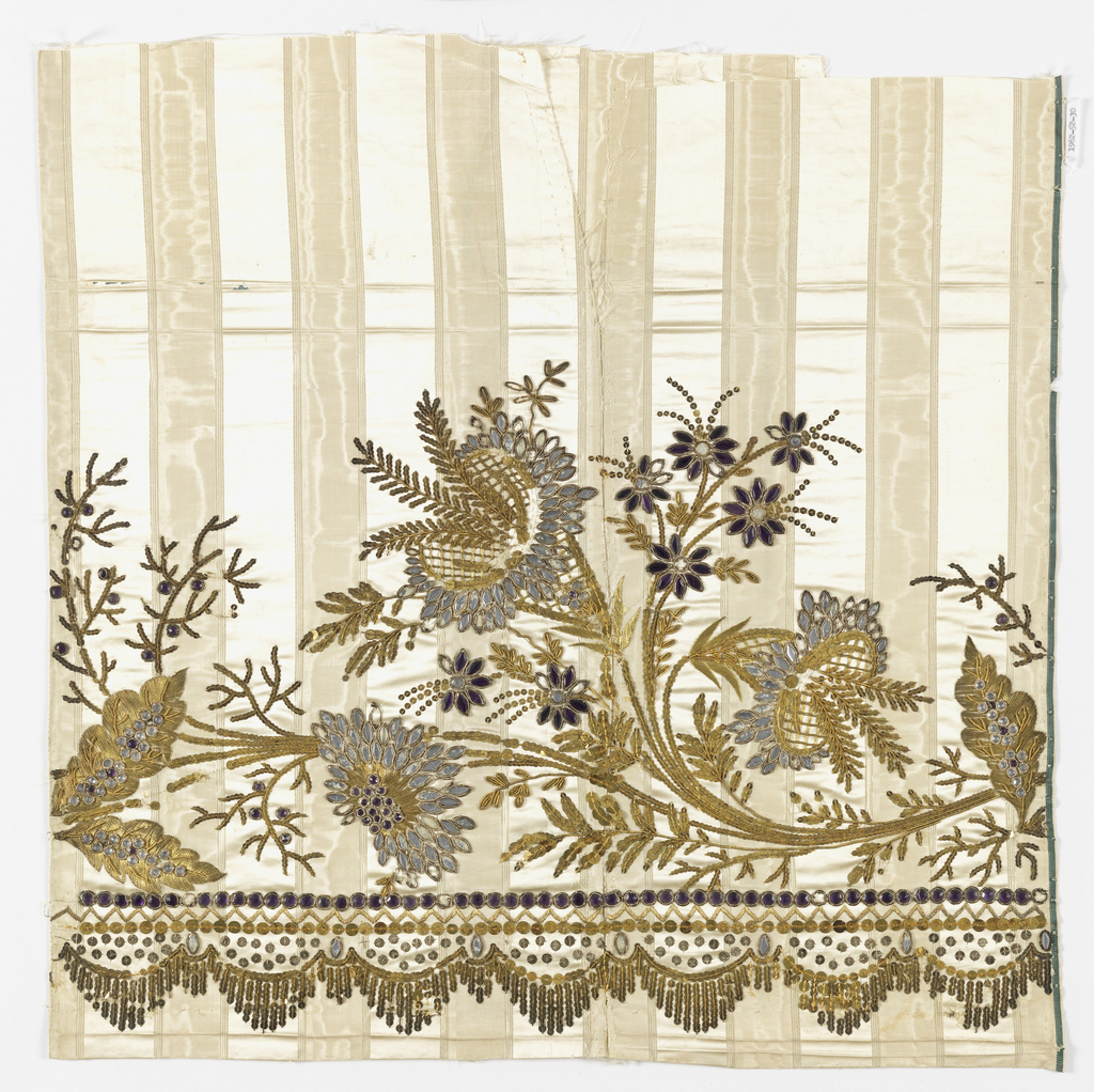 Fragment of white silk with moiré stripes embroidered with silk and metallic yarns showing design of flowers; stems composed of gold colored sequins, petals of appliquéd stones, and leaves of metallic yarn. Border at bottom showing horizontal lines of stones, sequins and metallic yarn, with swag of gold colored sequins.