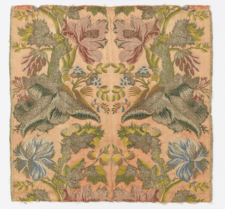 Salmon-pink satin brocaded with multicolored silks and gold metallic thread in a symmetrical pattern of flowers, foliage and fruit.