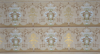 On light gray ground, scroll motifs, one with white feathers encompassing scalloped medallion in gray, alternating with gold motif, joined by pearl-like lines. Two borders printed across the width.