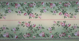 On gradient green and cream ground, pink roses and white vines with green leaves. Two borders printed across the width.