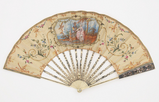 Gauze fan leaf with cartouche painted with a pastoral scene of a seated woman with a shepherd and small boy. Surrounded with painted flowers, musical trophies and spangles; verso: plain. Ivory sticks carved and decorated with gold in varying shades with inserts of spangles imitating jewels.