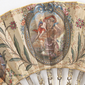 Pleated fan with painted silk leaf. Obverse shows medallions containing putti with flower sprays in between. Center medallion has a frame of gold metallic sequins. The flowers have red spangles and gold sequins. Reverse has the same design drawn in red on unpainted silk. Stick are carved in an openwork design (à jour) with gilding, silver and inserts of gilded wire screen. Guards carry ovals medallions containing a blacksmith and spinner that are appliqued to under parts in relief and covered with glass.