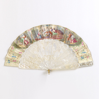 Pleated fan. Narrow parchment leaf with lithograph hand-colored in gouache. Obverse: heroic scene of patriarch (possibly Solomon) surrounded by women. Reverse: scenes of lovers in landscape in style of Louis XIV. Mother-of-pearl sticks and guards, carved à jour with floral and lattice designs. Scene of two women and a man on the sticks. Pin is set with a brilliant. Japanese box of lacquered wood inlaid with metal, lined with silk. Top set with metal cartouche and border, with metal lock and hinges. Red moire silk and paper lining.