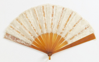 Pleated fan. Leaf of cream-colored Milanese bobbin lace, probably 18th century; it has been cut to make a fan with picot edge added to it.The reverse side of the lace has been used for the obverse of the fan leaf. Bail and sticks of a clear orange-colored material resembling shell.