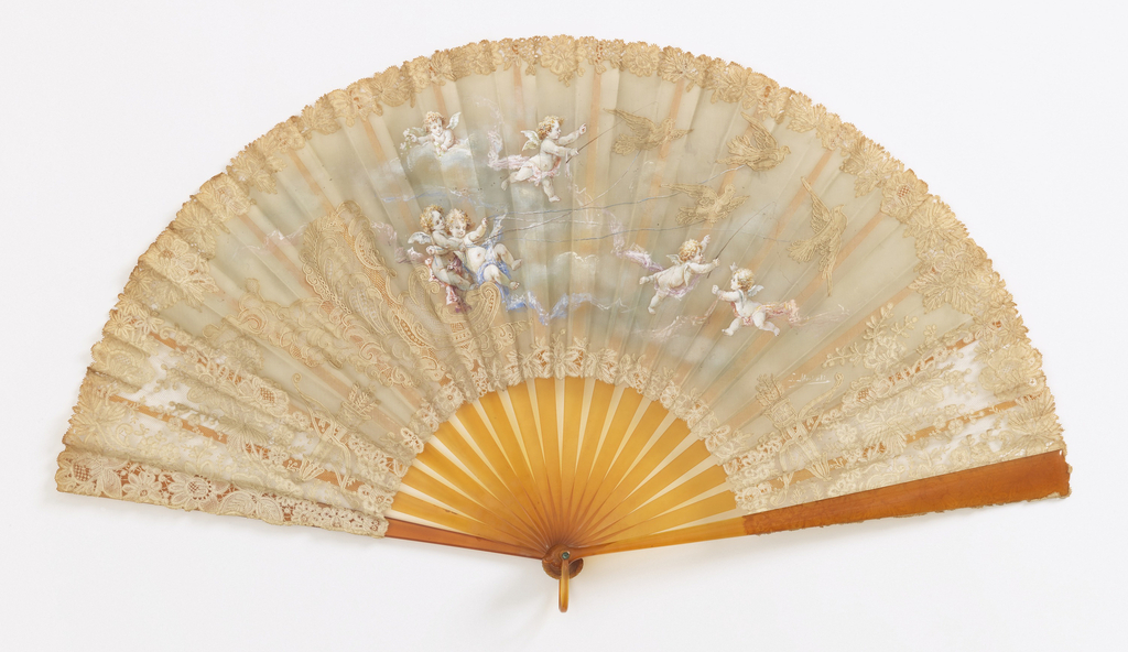 Pleated fan. Single leaf of duchesse lace (needle and bobbin laces) painted with scene of cherubs interacting with lace birds. Sticks of imitation tortoise with ribbon holder.