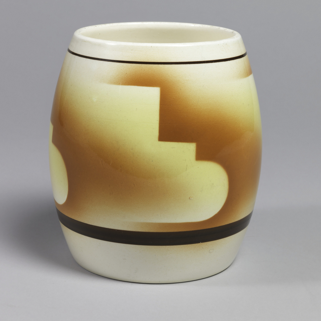 Barrel shape white body with a dark brown strip around the lower end. Above the stripe is red glaze that is separated by geometric light yellow outlines.