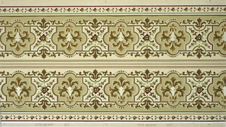 Borders printed two across. Wide central band of interlocking geometric shapes (puzzle-like), each containing stylized foliate motif, bordered by dot and floral motifs. Top has white mica beading, dark red stripe, green tan stripe. Bottom has band of green and red floral motif in between two sets of multicolored stripes. Ground is beige. Printed in shades of brown, green and tan on off-white ground. 