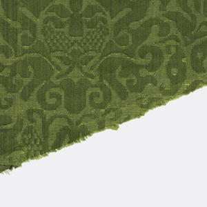 fragments from a chasuble. Palmette shapes within checkerboard strapwork in green.