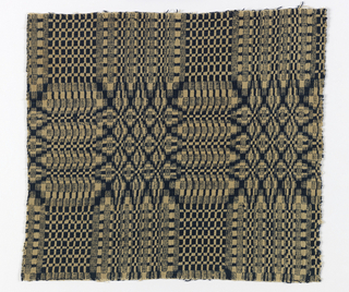 """Coverlet fragment in deep blue and undyed wool showing abstract """"whig rose"""" pattern."""