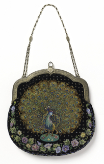 Small purse with a gold-colored metal frame and chain, black velvet exterior with beadwork embroidery, lined with pale turquoise satin with vegetal design in gold floats. The beadwork designs are derived from 8th-10th century Near Eastern silks: on one side a gazelle under a flowering tree; on the other a peacock with spreading tail, with a floral vine at the curved lower edge of the bag. In variously colored glass beads with pinks, mauves, and peacock blues predominating.