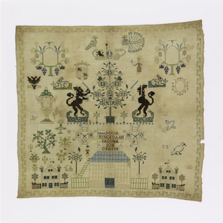 Confronted lions separated by a flowering tree with angels surrounded by isolated motifs.  Right side of sampler is unfinished.
