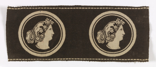 Border fragment of black silk velvet with a printed design of classical female heads in profile surrounded by a double circle in white.