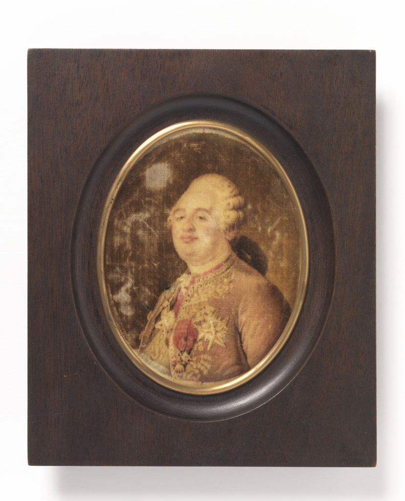 Portrait of Louis XVI in an oval wooden frame. Gregoire velvet in shades of brown and red.