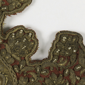 Four separate ornaments, cruciform, with center circular medallions framing pictorial representations of Saints (apostles). Faces and hands in fine silk split stitch; balance in metal with halos in high relief, on red satin, with details in pearls. Top and bottom oblong medallion with inscription.