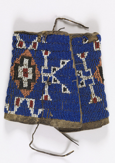 Arm band of hide, beaded in a geometric pattern of white, black and orange on blue.