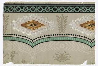 Frieze on beige ground, diamonds of yellow-gold-tan shaded; foliage in white scrollwork diamond frame.  Green and black bandings, beading and bunches of flowers in brown, top of broad arches, paler beige leather like leaves.