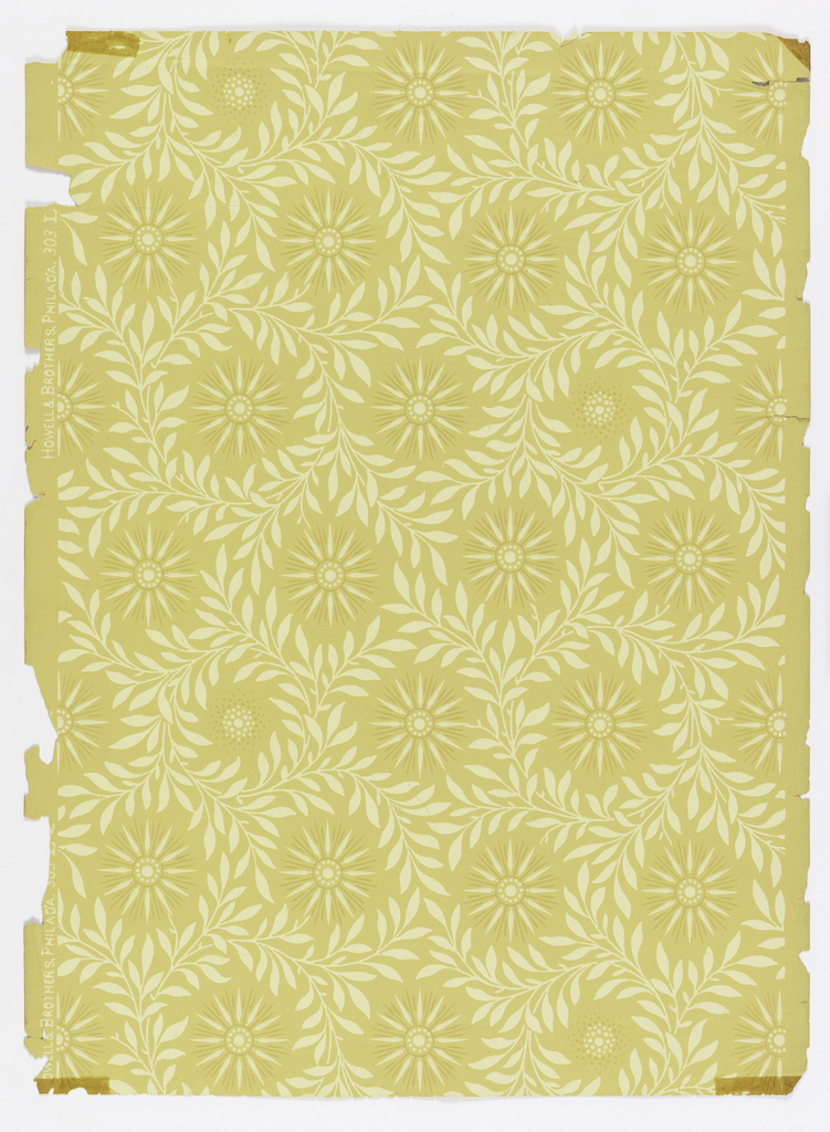 Starburst motif encircled in willow framework. Printed in off-white and tan on light yellow ocher ground.