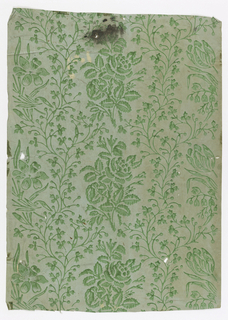 Green flowers and vines. Printed on green ingrain paper.