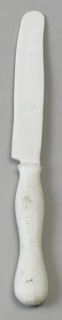 White-painted balsa wood knife with flat blade, curved at end; contoured cylindrical handle.