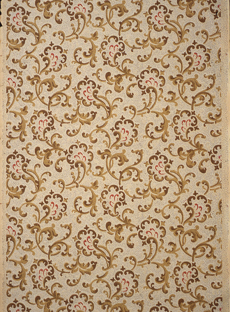 On beige textured ground, allover scrolls in shades of brown.