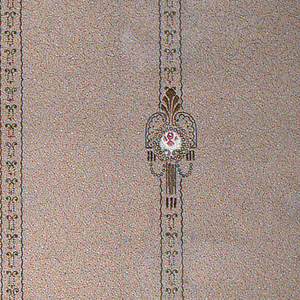 On textured gray ground, thin vertical bands containing double scrolls with staggered medallions composed of central motif in white with pearl border surrounded by acanthus leaf, pearl garlands and half arcs.
